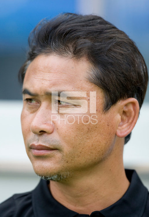 Japanese head coach Nono Sasaki watches his team before first round play in the 2008 Beijing Olympics at Qinhuangdao, China. .  Japan tied New Zealand, 2-2, at Qinhuangdao Stadium.
