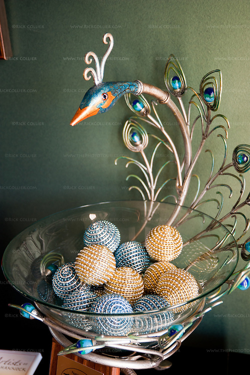 A decorative peacock bowl on display near the door at Narmada Winery.