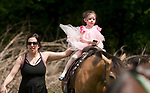 BETHLEHEM,  CT-052017JS19- Wither her mother Deanna Russo by her side, Anabelle Russo, 3, of Watertown, enjoys a pony ride during the seventh annual Fairy Festival Saturday at the Bellamy-Ferriday House and Gardens in Bethlehem. <br /> Jim Shannon Republican-American