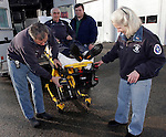 ROXBURY, CT05 January 2006-010506TK11 (left to right:) Roxbury  Ambulance has purchased a $9,500 stretcher with a power lift, the first of its kind in the state. The unit is powered by rechargeable battery, similar in size to batteries that power hand power drills. Demonstrating the new equipment are Roxbury Ambulance Chief Bernie Meehan, along  Roxbury Ambulance Volunteers Donald Greenstein, Aaron Hodge and Mary Elizabeth Peck.  Tom Kabelka / Republican-American (Roxbury  Ambulance, Bernie Meehan, Donald Greenstein, Aaron Hodge, Mary Elizabeth Peck)CQ