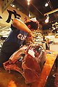 File photo - A japanese fisherman cutting a tuna, Sep 5th 2008 : In the early morning, fishermen starts selling their fresh fish at the fish market in Tsukiji, Japan. (Photo by Takuya Matsunaga/AFLO)
