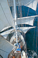 Isle of Skye, Hebrides, Scotland, May 2010. Raising the sails requires high altitude acrobatics. From the mast one gets an impressive aerial view over the ship. Tallship Thalssa cuts through the water under full sail. Dutch Tallship Thalassa sails between the islands along the Scotish west coast in search of the quality single malt whisky that is produced by the many distilleries. Photo by Frits Meyst/Adventure4ever.com