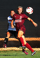 WINSTON-SALEM, NORTH CAROLINA - August 30, 2013:<br />  Charlyn Corral (9) of Louisville University sends a cross past Katie Yensen (3)of Virginia Tech during a match at the Wake Forest Invitational tournament at Wake Forest University on August 30. The game ended in a 1-1 tie.