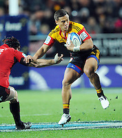 Chiefs Tim Nanai-Williams, right, slips around the Crusaders Matt Todd in the Super 15 Rugby semi final match, Waikato Stadium, New Zealand, Friday, July 27, 2012. Credit:SNPA / Ross Setford