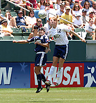 27 June 2004: Cindy Parlow (12) and Shannon MacMillan (8) challenge for a header. The San Diego Spirit defeated the Carolina Courage 2-1 at the Home Depot Center in Carson, CA in Womens United Soccer Association soccer game featuring guest players from other teams.