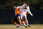 12 November 2013: Virginia's Jordan Allen (8) and Wake Forest's Ian Harkes (16). The Wake Forest University Demon Deacons hosted the University of Virginia Cavaliers at Spry Stadium in Winston-Salem, North Carolina in a 2013 NCAA Division I Men's Soccer match and the quarterfinals of the Atlantic Coast Conference tournament. Virginia won the game 1-0 in overtime.