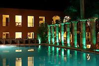 Night shot of the swimming pool at the Hotel Hacienda Uxmal near the Mayan ruins of Uxmal, Yucatan, Mexico.