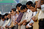 Muslim men stop to pray on the street in Lahore, Pakistan. The country has a Muslim majority.