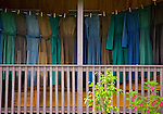 Mennonites pin up their freshly washed clothes on the veranda of their homes, Springfield, Cayo District, Belize