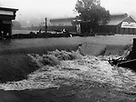 Raging floodwaters in Thomaston new Plume & Atwood plant.