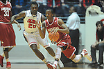 "Arkansas' B.J. Young (11) vs. Ole Miss' Nick Williams (20) at the C.M. ""Tad"" Smith Coliseum in Oxford, Miss. on Saturday, January 19, 2013. Mississippi won 76-64. (AP Photo/Oxford Eagle, Bruce Newman)"