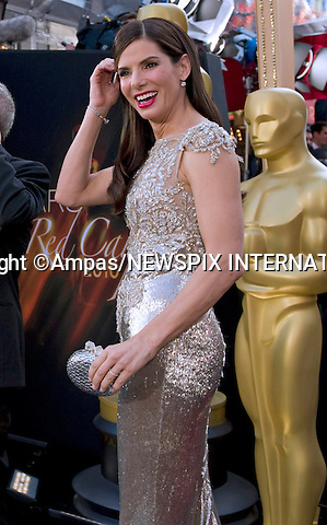 """SANDRA BULLOCK.arrives at the 82nd Annual Academy Awards at the Kodak Theatre in Hollywood, CA, on Sunday, March 7, 2010..Mandatory Photo Credit: Newspix International..**ALL FEES PAYABLE TO: """"NEWSPIX INTERNATIONAL""""**..PHOTO CREDIT MANDATORY!!: NEWSPIX INTERNATIONAL(Failure to credit will incur a surcharge of 100% of reproduction fees)..IMMEDIATE CONFIRMATION OF USAGE REQUIRED:.Newspix International, 31 Chinnery Hill, Bishop's Stortford, ENGLAND CM23 3PS.Tel:+441279 324672  ; Fax: +441279656877.Mobile:  0777568 1153.e-mail: info@newspixinternational.co.uk"""