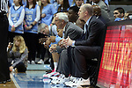 24 January 2015: UNC head coach Roy Williams (center) and his staff wear sneakers as part of the American Cancer Society's Coaches vs. Cancer campaign. The University of North Carolina Tar Heels played the Florida State University Seminoles in an NCAA Division I Men's basketball game at the Dean E. Smith Center in Chapel Hill, North Carolina. UNC won the game 78-74.
