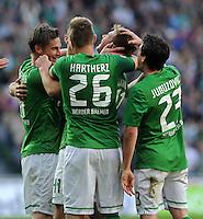 FUSSBALL   1. BUNDESLIGA   SAISON 2011/2012   27. SPIELTAG SV Werder Bremen - FC Augsburg                        24.03.2012 Torjubel nach dem 1:0: Markus Rosenberg, Florian Hartherz, Niclas Fuellkrug, Zlatko Junuzovic (v.l., beide SV Werder Bremen)