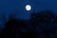 The moon rises over a barn in Madison County, VA.   Photo/Andrew Shurtleff