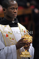 Sacred Chalices;Pope Benedict XVI holds a candle during the Easter vigil mass in Saint Peter's Basilica, in the Vatican, late  April 23, 2011