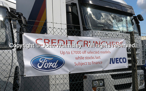 Discount sign to encourage sales of trucks during the credit crunch..