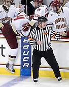 Parker Milner (BC - 35) and Patrick Brown (BC - 23) help Tommy Cross (BC - 4) over the boards after he sprained his knee. - The Boston College Eagles defeated the visiting Merrimack College Warriors 3-2 on Friday, October 29, 2010, at Conte Forum in Chestnut Hill, Massachusetts.