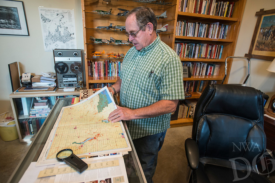 NWA Democrat-Gazette/ANTHONY REYES &bull; @NWATONYR<br /> James Crownover looks over some maps Thursday, Sept. 24, 2015 he uses while writing his book at his home in Elm Springs. Crownover won two Spur awards for his first published western novel.