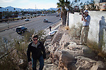 Press and onlookers gather near the Safeway in unincorporated Pima County where Jared Loughner opened fire on Rep. Gabrielle Giffords and a crowd of people gathered to speak with her at her regular 'Congres on the Corner' event.  Loughner killed six and wounded another[ number]....  Scenes from Tucson, Arizona in the days following a mass shooting that left six dead and [number] injured.  The shooter, identified as Jared Loughner, was captured at the scene and charged in federal court on January 9th, 2011.  Among the injured was democratic congresswoman Gabrielle Giffords.  The dead included a federal judge, a nine year-old girl, and several septaugenarians who had all come to see the congresswoman at one of her 'Congress on the Corner' events.