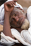 In Ouagadougou, Burkina Faso, an elderly Touareg man lays his head on his arm for an afternoon nap.   The Touareg are a nomadic ethnic group that are traditionally pastoralists.