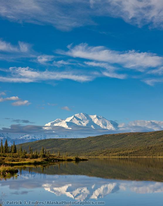 Late morning sunshine on Wonder Lake reflecting the north face summit of Mt. McKinley, North America's largest mountain, Denali National Park, interior, Alaska.
