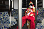 A dejected 49er fan rides the airport bus to get outta town, after a defeat by the Seahawks.