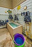 12 July 2013: The Divetech gear rinse bin and drying racks are located beside the dive shop at Cobalt Coast Resort, in West Bay, Grand Cayman Island. Located in the British West Indies in the  Caribbean, the Cayman Islands are renowned for excellent scuba diving, snorkeling, beaches and banking.  Mandatory Credit: Ed Wolfstein Photo *** RAW (NEF) Image File Available ***