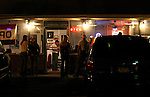 People hang out at  The Lantern Inn in Gainesville, Ga. on Saturday, Dec. 16, 2006. Mike Jones has been performing as Elvis at the eatery for 18 years, but Saturday was the curtain call. The Lantern Inn closed its doors on Sunday after over 40 years of business.<br />
