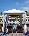 The Four Seasons Resort Hualalai at Historic Kaupulehu on the Big Island of Hawaii. Cabanas line the Beach Tree Pool.