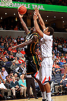 CHARLOTTESVILLE, VA- DECEMBER 6: Vertrail Vaughns #11 of the George Mason Patriots shoots in front of Malcolm Brogdon #22 of the Virginia Cavaliers during the game on December 6, 2011 at the John Paul Jones Arena in Charlottesville, Virginia. Virginia defeated George Mason 68-48. (Photo by Andrew Shurtleff/Getty Images) *** Local Caption *** Malcolm Brogdon;Vertrail Vaughns