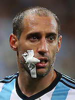 Pablo Zabaleta of Argentina wears a dressing on his right cheek after suffering a deep wound