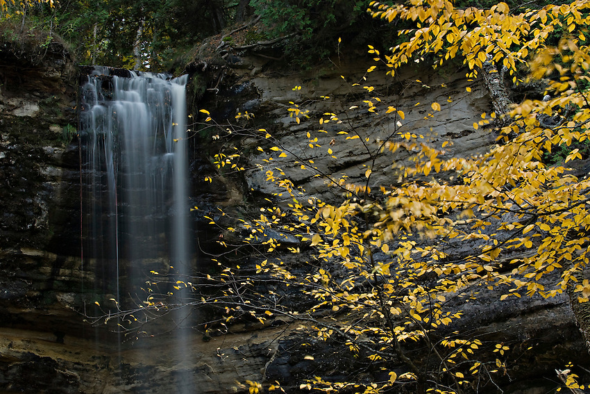 Munising Falls with fall color at Pictured Rocks National Lakeshore in Munising Michigan.