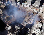 Ground Zero, New York City, N.Y.  - Sept. 17, 2001 -- An aerial view shows only a small portion of the crime scene where the World Trade Center collapsed following the September 11, 2001 terrorist attack on September 17, 2001.  Surrounding buildings were heavily damaged by the debris and massive force of the falling twin towers.  Clean-up efforts are expected to continue for months.  .Credit: Eric J. Tilford - US Navy via CNP