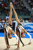 Members of Ukrainian group perform back walkover in unison during hoops+clubs event final at 2008 European Championships at Torino, Italy on June 7, 2008.  Photo by Tom Theobald.