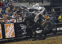 Thousands of people crowded into the Gwinnett Center for an evening of energized violence and brutality. The Toughest Cowboy competition had arrived at the Gwinnett Center in Duluth. The contest involved 12 cowboys competing in the triathlon of cowboy chaos, bareback bronc riding, saddle bronc riding and bull riding. <br />