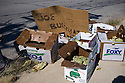 Boxes with left over vegetables stand on the sidewalk  Detroit, USA, 2011