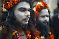 Two Ash smeared Naga Sadhus walking around in Juna Akhara during the Kumbh Mela in Haridwar, 2010. Naga Sadhus belong to the Shaiva sect, they have matted locks of hair and their bodies are covered in ashes like Lord Shiva.<br />
