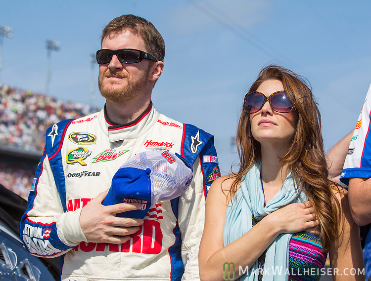 Dale Earnhardt Jr. and his girlfriend Amy Reimann during the National Anthem prior to the start of the NASCAR Sprint Cup Series Budweiser Duel #1 at Daytona International Speedway in Daytona Beach, Florida February 21, 2013.