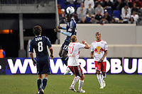 Kei Kamara (23) of Sporting Kansas City heads the ball. The New York Red Bulls defeated Sporting Kansas City 1-0 during a Major League Soccer (MLS) match at Red Bull Arena in Harrison, NJ, on April 30, 2011.
