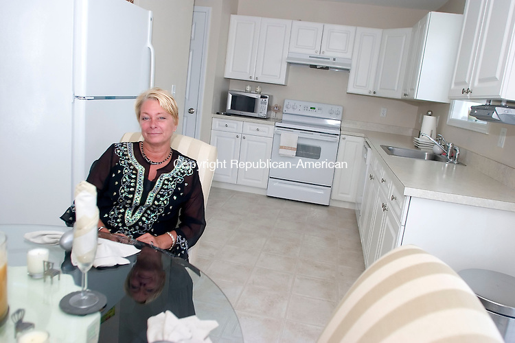 WATERBURY, CT- 17 JULY 2007- 071707JT03-<br /> Developer and realtor Teri Bennett inside the kitchen of a Beau View Pointe condominium in Waterbury on Tuesday, July 17.<br /> Josalee Thrift / Republican-American