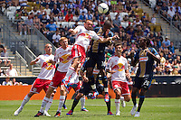 Brandon Barklage (25) of the New York Red Bulls and Danny Mwanga (10) of the Philadelphia Union go up for a header. The New York Red Bulls defeated the Philadelphia Union  3-2 during a Major League Soccer (MLS) match at PPL Park in Chester, PA, on May 13, 2012.