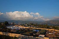 A soccer stadium in Jacmel has been converted into a tent city for people left homeless by the January 12 earthquake. Venezuelan soldiers have some control in the camp and are slowly replacing homemade structures with larger Army tents. The 7.0 earthquake that devastated parts of Haiti on January 12 killed hundreds of thousands of people. January's earthquake killed hundreds of thousands of people and caused significant and lasting structural and economic damage in the Caribbean nation.