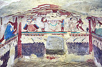 "Underground Etruscan tomb Known as ""Tomba delle Leonesse"". A single chamber with double sloping ceiling decorated with a painted chequered design. Six painted columns divide the walls to give the tomb the appearance of a pavillion. In the typanium of the back wall are two lionesses below which is a large Krater used to mix water and wine, flanked by two musicians and a female dancer.  Circa 520 BC. Excavated 1874, Etruscan Necropolis of Monterozzi, Monte del Calvario, Tarquinia, Italy. A UNESCO World Heritage Site."