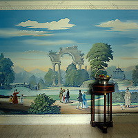The hand-painted walls of the dining room by Pierre-Marie Rudelle depict people promenading through parkland filled with pagodas, bridges and classical ruins