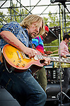 Devon Allman with Cyril Neville and Mike Zito in the background performing in The Royal Southern Brotherhood at the 2012 Backyard BBQ held at Wiggins Park in Camden, NJ.