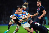 Matias Moroni of Argentina is double-tackled by Tom Wood and Teimana Harrison of England. Old Mutual Wealth Series International match between England and Argentina on November 26, 2016 at Twickenham Stadium in London, England. Photo by: Patrick Khachfe / Onside Images