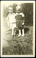 BNPS.co.uk (01202 558833)<br /> Pic: Juliens/BNPS<br /> <br /> Candid photos of a four year old Marilyn Monroe with her first friend have emerged for auction.<br /> <br /> The vintage black and white photographs which were taken in 1930 feature a young Norma Jean Baker with a young boy of the same age named Lester Bolender who was placed in the same foster family as her. <br /> <br /> Monroe's first foster home placement was with the Bolender family and she and Lester were so close they became known as 'the twins'. <br /> <br /> The photos measure 4 1/2in by 2 7/8in and have notes on the back which read 'Marilyn Monroe age 4yrs'.