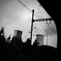 Cooling towers of the Prunéřov I coal-fired power plant seen from the train passing through the industrial area in the north of the Czech Republic, 4 September 2013. The whole nothern region of the country constantly suffers environmental impacts from the coal mining and the coal-fired energy production.