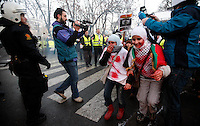 Norwegian camera man Ammar Al-Hamdan from Al-Jazeera filming in Oslo 2009. While on assignment in Libya in March 2011 he was captured by government forces, along with three colleagues.   <br /> <br /> Pro-Palestinian protesters clashed with police as they held a counter demonstration against pro-Israel campaigners in the Norwegian capital Oslo. Violent clashes lasted for hours  in the centre of Oslo. Both groups came to the streets as a result of the violence in Gaza. Israeli forces began a series of air strikes on the Gaza Strip on the 27th of December in retaliation against Hamas rockets fired into Israel. After eight days of bombardment, leaving over 400 Palestinians and four Israelis dead, Israeli tanks launched a ground invasion on the 4th of January.